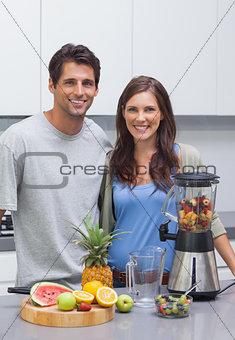 Couple cutting fruits