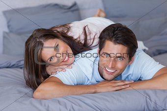 Lovely couple smiling at camera
