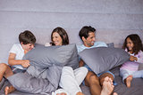 Family having fun together on bed