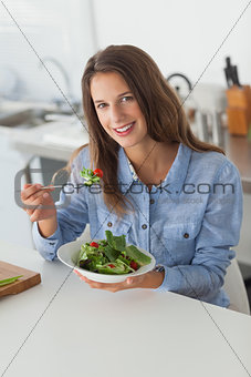 Attractive woman eating a salad