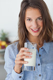 Pretty woman holding a glass of milk
