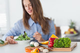Pretty woman eating a vegetarian salad
