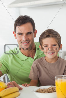 Portrait of father and son during breakfast
