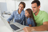 Family using a laptop pc in the kitchen