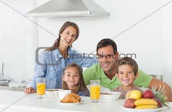 Portrait of cute family having breakfast