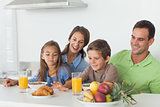 Parents having breakfast with children