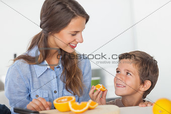 Little boy eating orange segments