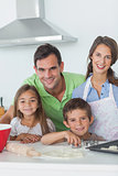 Family home baking together in the kitchen