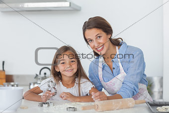 Portrait of mother and daughter baking together