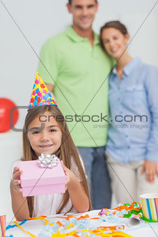 Little girl holding a birthday gift