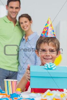 Little boy holding his birthday gift