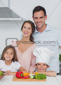 Beautiful family standing in the kitchen