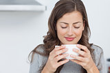 Woman waking with the smells of coffee