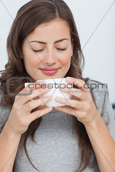 Woman waking with the scent of coffee