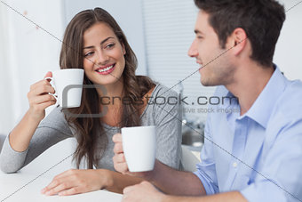 Beautiful couple drinking a cup of coffee