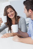 Cheerful couple drinking a cup of coffee