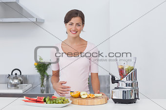 Pregnant woman making a fruit cocktail