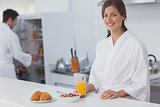 Woman having breakfast with cereal and orange juice
