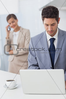 Businessman using a laptop before going to work