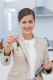 Real estate agent offering house key