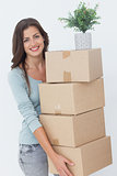 Woman carrying boxes because she is moving