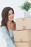 Woman holding boxes because she is moving