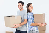 Wife and husband carrying boxes