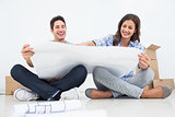 Man and his wife looking at their house plans