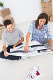 Woman and her husband looking at their house plans