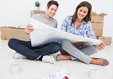 Man and woman looking at their house plans