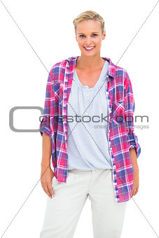 Attractive woman standing and looking at camera