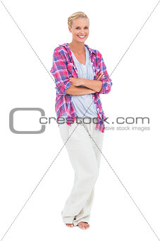 Blonde woman standing with arms crossed
