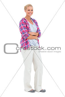 Cheerful woman standing with arms crossed