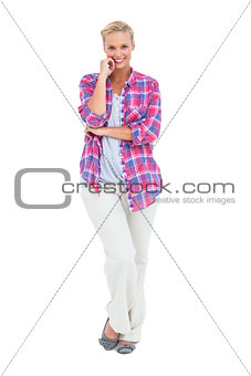 Happy woman standing looking at camera