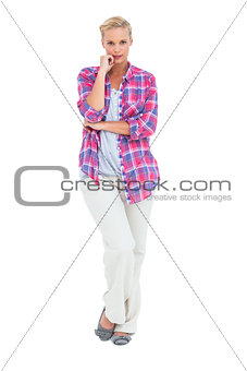 Pretty woman standing looking at camera