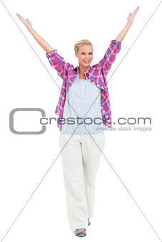 Blonde woman standing with hands up
