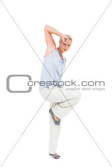 Blonde woman gesturing and looking at camera