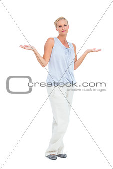 Blonde woman with arms raised in question looking at camera