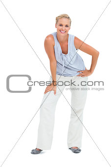 Blonde woman bending and looking at camera