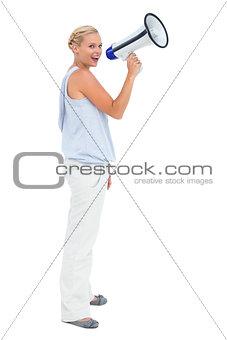 Blonde shouting through megaphone