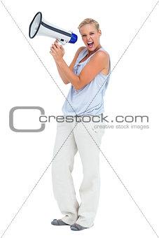 Blonde screaming holding megaphone