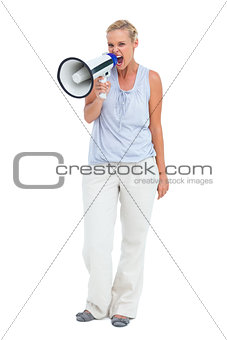 Blonde shouting holding a megaphone