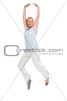 Blonde woman jumping like a ballerina