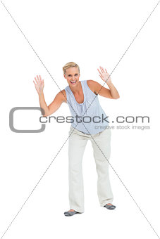Blonde woman bending with hands up