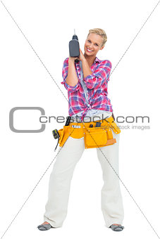 Blonde standing with a power drill