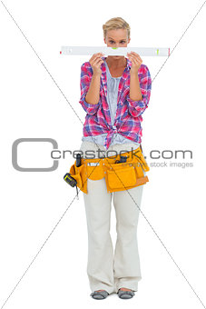 Blonde woman looking at spirit level
