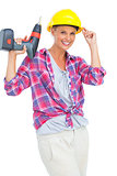 Smiling handy woman holding a power drill