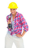 Smiling handy woman with a power drill
