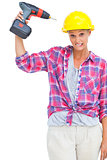 Attractive handy woman holding a power drill