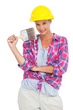Beautiful handy woman holding a brush